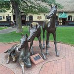 Deer statues at train station.