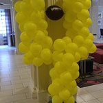 Balloon goal post in the lobby for game day.