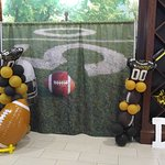 Picture wall with props for game day.