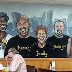 part of the full length wall mural featuring Herm's family