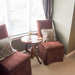 Small sitting area in the bedroom. Window looks down into the parking lot behind the Inn