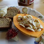 Breakfast: papaya boat with yogurt, banana, almonds; banana bread; rambutan; nice strong coffee