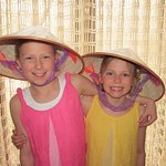 Kids happy with colonial Hats from Vietnam