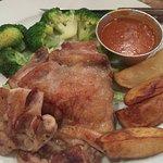 Chicken chop is bland, vegetable undercooked.