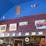 The wall depicting the Full Moon Café through the years.