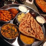 Delicious entrees including chick peas, naan, basmati rice, lentils, and more.