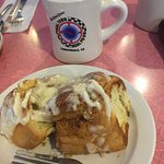 Cinammon roll with coffee cup
