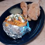 Grilled Chicken Tenders with homemade bread stuffing AND gravy and loaded baked potato
