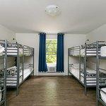 8 bed dorm, other room types include 4-bed and 6-bed configurations