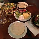 fajitas, chicken and merguez (lamb sausage) accompanied with side dishes