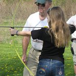 Special activity days, such as scout day, include activities like archery.
