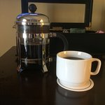 French press coffee maker in room
