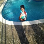 my daughter enjoying the pool with her little brothers life vest.... lolol
