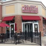 Corner entrance & outdoor seating for Real Urban Barbecue