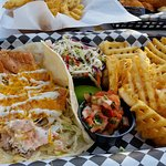Salmon tacos and waffle fries.