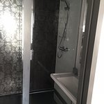 Power shower, bath and basin in bathroom