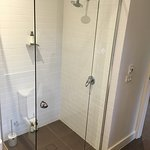 Shower area + heated flooring controls on the wall