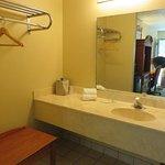 Sink/vanity area separate from toilet.