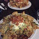 Vegetarian nachos (chicken nachos in background)