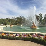 A magnificent fountain surrounded by nice gardens and beautiful flowers. Adjacent to the royal p