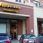 Entrance to Eggsperience Pancakes & Cafe from parking lot