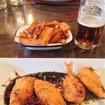 Foreground: Breaded butterfly King prawns in Hoisin sauce. Midground: Sweet potato chips.