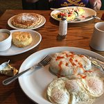 Country fried steak and eggs, biscuit and gravy side, Greek omelette and pancakes pictured