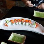 Dancing Fire Roll - real crab meat, avocado, cucumber, on top w/smoked salmon, cream cheese & ro
