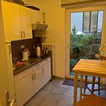 Kitchen in the apartment, exit to the terrace.
