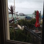 view of the old West Pier from the room, including their outside eating areas.
