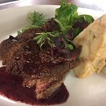 pan fried calf liver- three onion bread pudding, dressed greens, red wine pan sauce