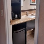 Room 425 bathroom: fridge, microwave, coffee maker, and ice bucket in the bathroom
