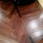 Herringbone floor in room.