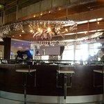 Bar near dining area Reef Hotel