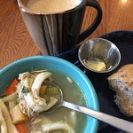 Homemade chicken noodle soup, hot whole grain roll with butter and honey!  Very good latte!  So