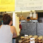 Order from the counter, choose a slice then wait for number to be called to pick up food.