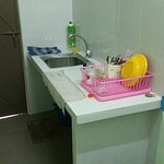 Wash basin in the kitchen. The door opens out to the back lane.