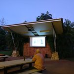 Big screen TV in outdoor dining and bar area