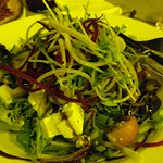 Greek salad (looks yellow because of yellow coloured lights in outdoor area don't attract the bu