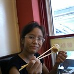practising the use of chopsticks