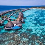 Fly in via seaplane to the bespoke luxury island of W Maldives, surrounded by turquois waters &
