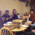 The legendary Tom Carroll and crew enjoying their post-surf pizza fix