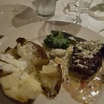 My steak with blue cheese butter and baked potato.