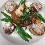 seared scallops with a lemon thyme beurre blanc, parmesan risotto cake and lobster