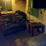 nice love seat and chair area very spacey room