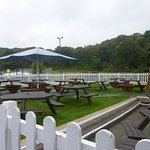 Large tidy outdoor seating area with clean tables ..