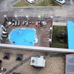 Part of the pool and an entrance from the balcony, it is an indoor and outdoor pool.