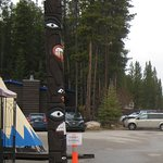 Totem and teepee outside restaurant and gift shop