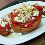 Dakos, a Cretan snake of rusk bread, tomato, oregano and cheese (feta, gruyere or similar)