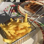 Grilled Ham and Cheese Sandwich with a small basket of fries